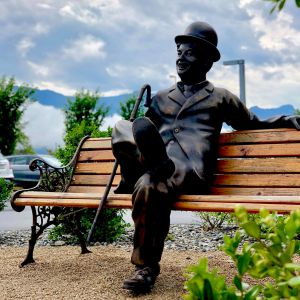 On a bench with Charlie Chaplin